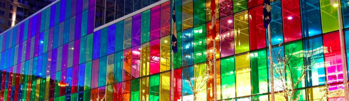 Oracal colored transparent adhesive pictured on the side of a glass building