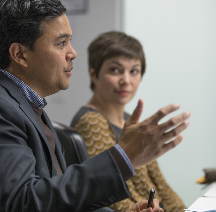 Mark Latonero of Data & Society leads a discussion in the Tech/Law Colloquium while Karen Levy, assistant professor of Information Science and Colloquium course instructor, looks on.