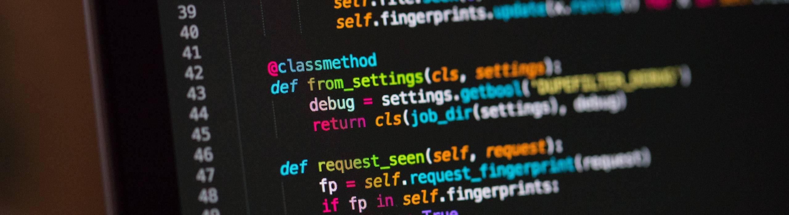 Close-up of laptop screen showing programming language
