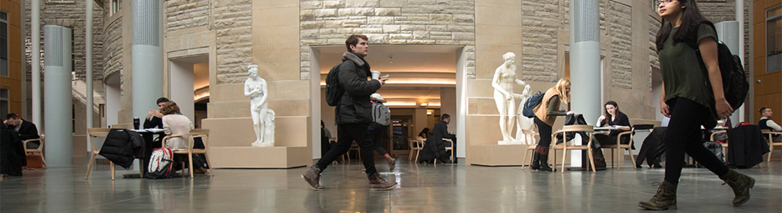 Arts and Sciences (CAS) students walk through the Klarman Hall atrium.