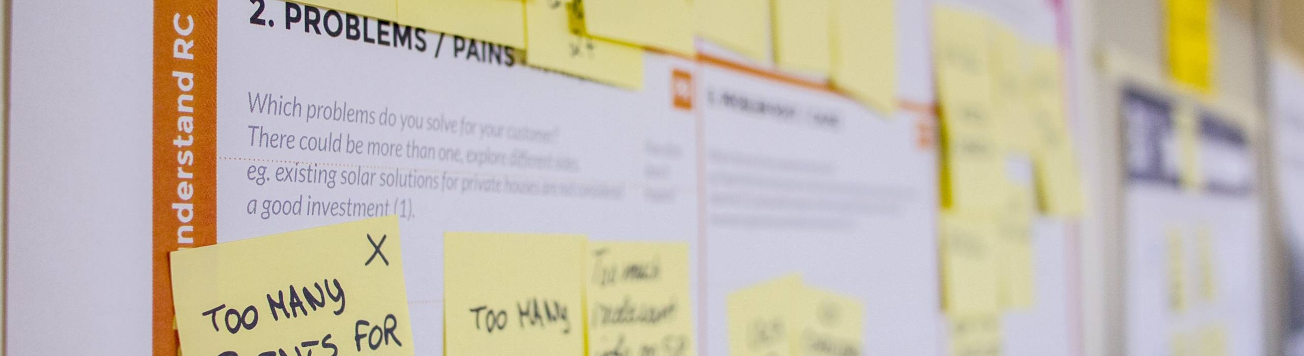 Post-it Notes pinned to a big board