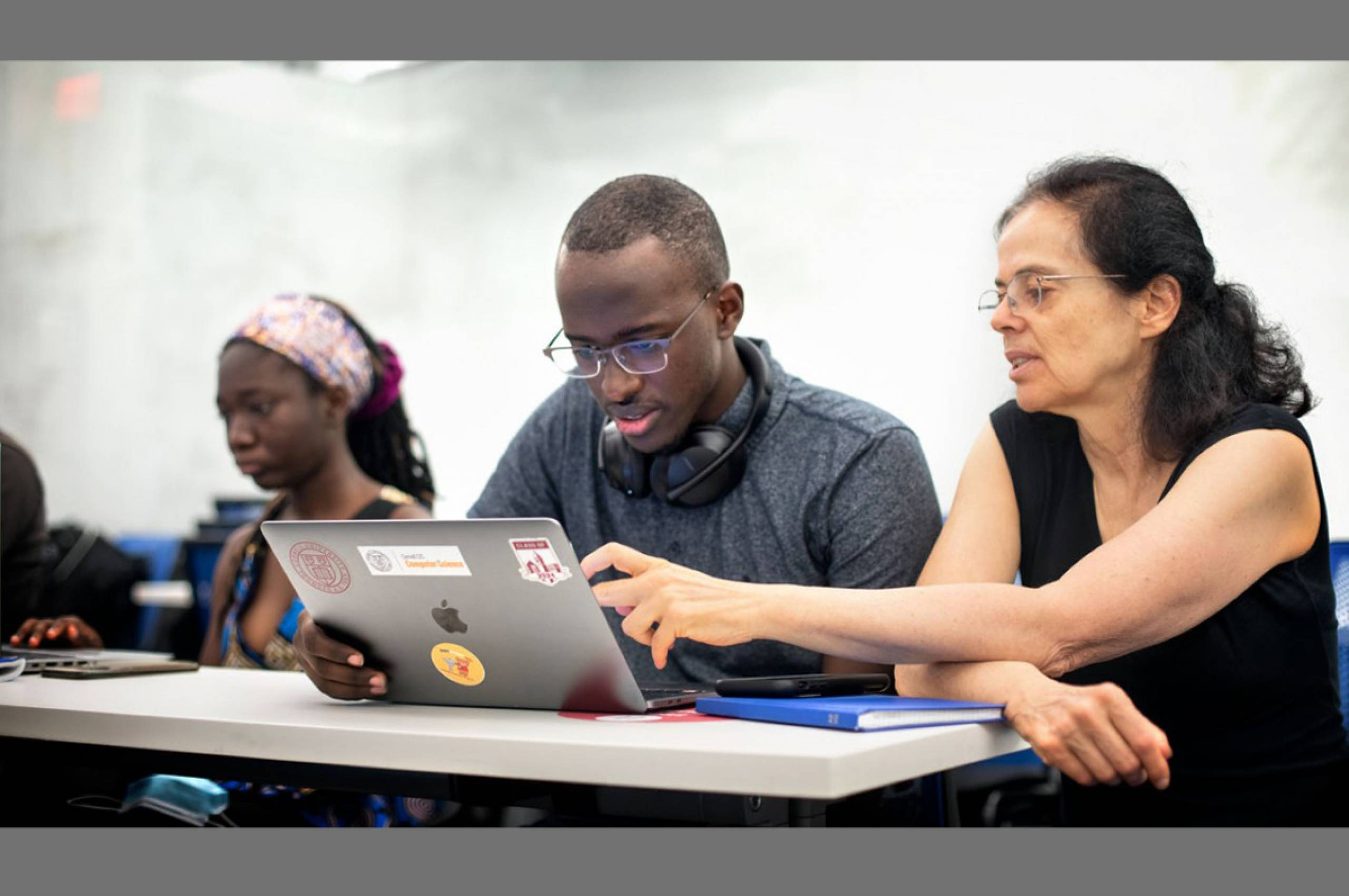 Éva Tardos, the Jacob Gould Schurman Professor of Computer Science, works with students during the 2021 CSMore class in Gates Hall. (photo: Jason Koski)
