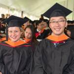 Two Info Sci students during 2018 Commencement ceremonies.